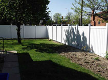 Privacy vinyl fencing installation by wood fence